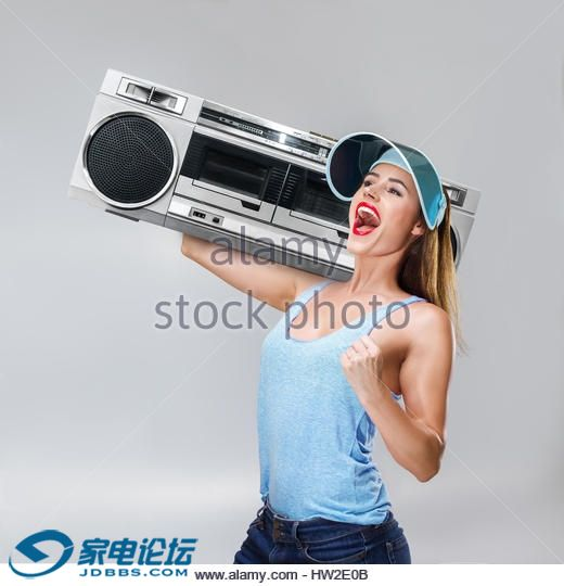 young-happy-sport-style-fashion-woman-listening-music-with-boombox-hw2e0b.jpg